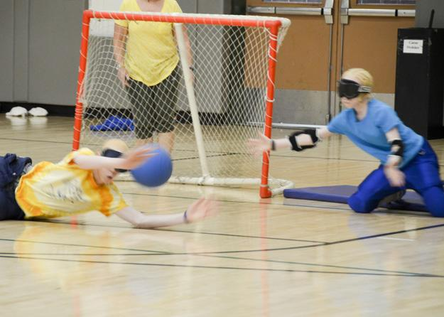 Campers learning about goalball