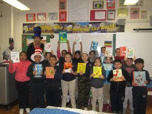 3rd grade class holding up their favorite dr. seuss books