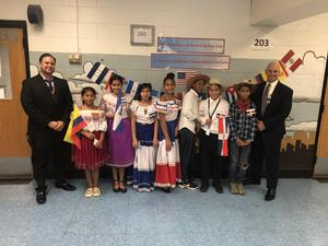 Vp Abbato with Principal Aleman and several students dressed in their folk attire