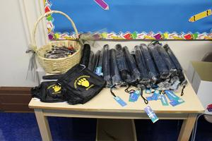 Jefferson Jaguar umbrellas, bags, and pens on table