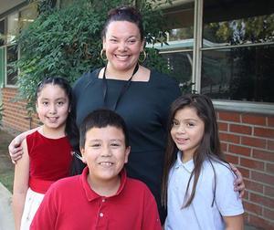 Principal Dr. Alvarez with Students