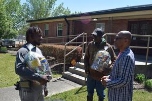 Superintendent Ellis touches the lives of McComb School District Maintenance Employees with Random Acts of Kindness Basket.