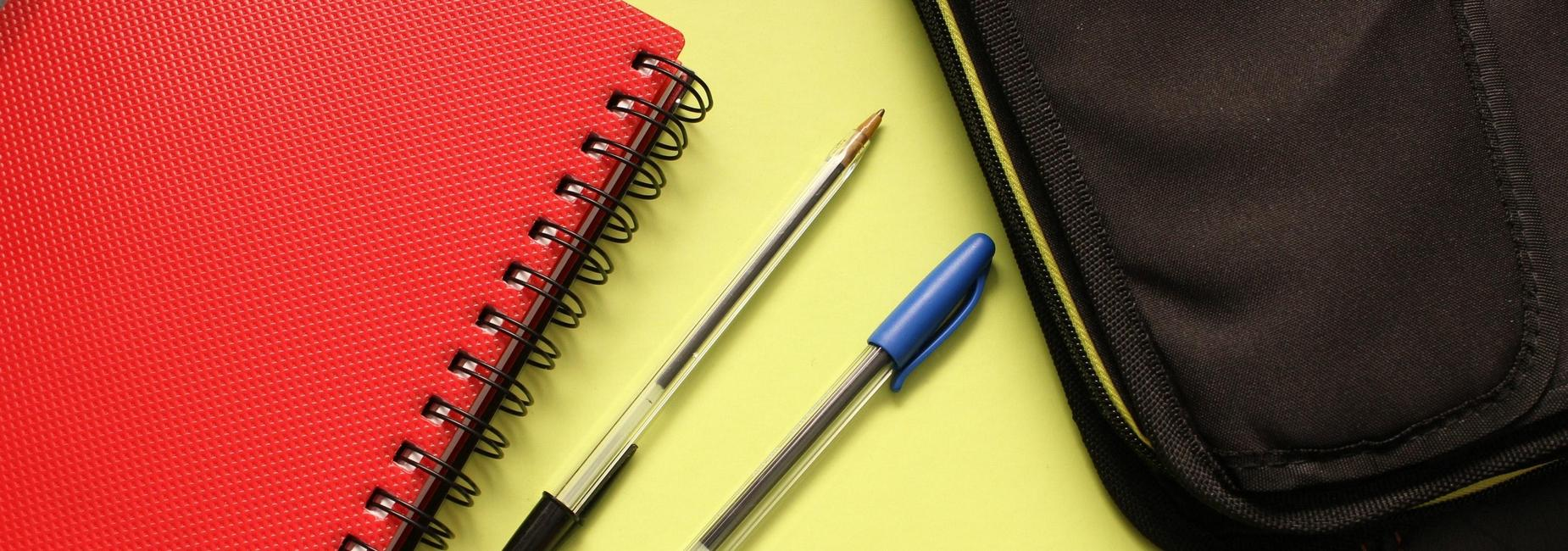 Photo of composition books and pens