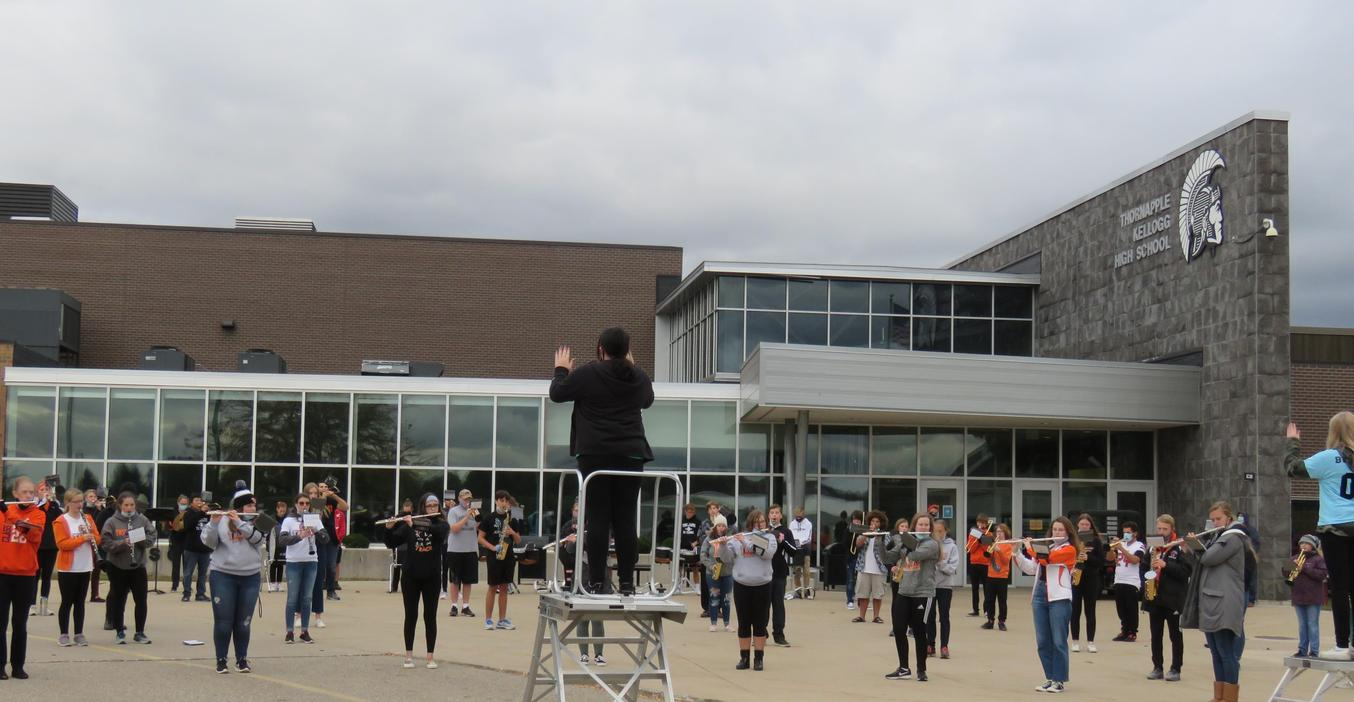 TKHS  band performs outside the stadium because of COVID restrictions.