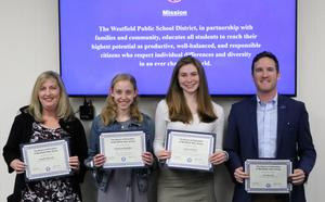 Members of the WHS Girls Winter T&F team and their coaches were recognized at the March 26 meeting of the Board of Education.