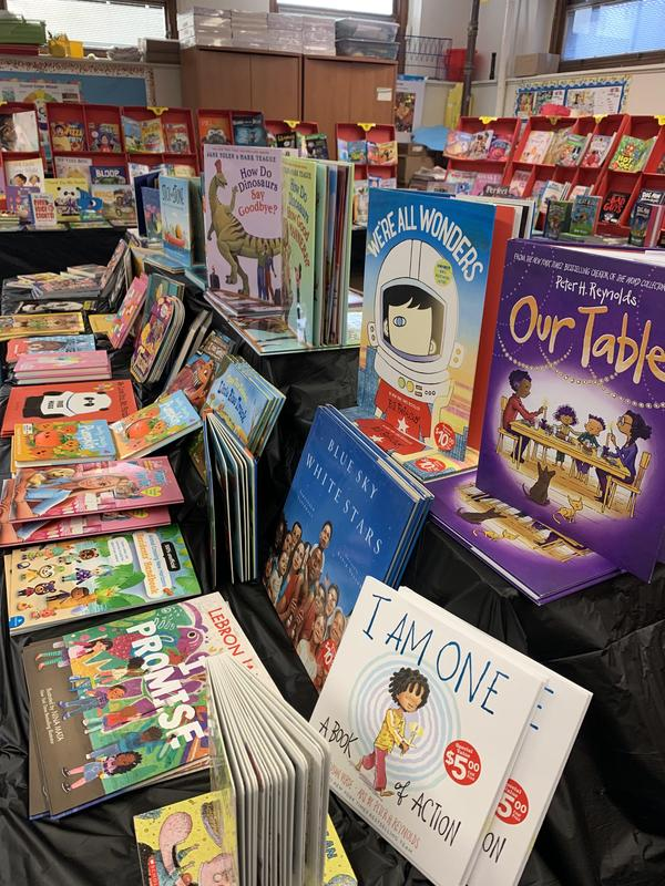 Books displayed on black table cover