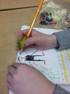 A pencil helps place the thumb and fingers in correct position.
