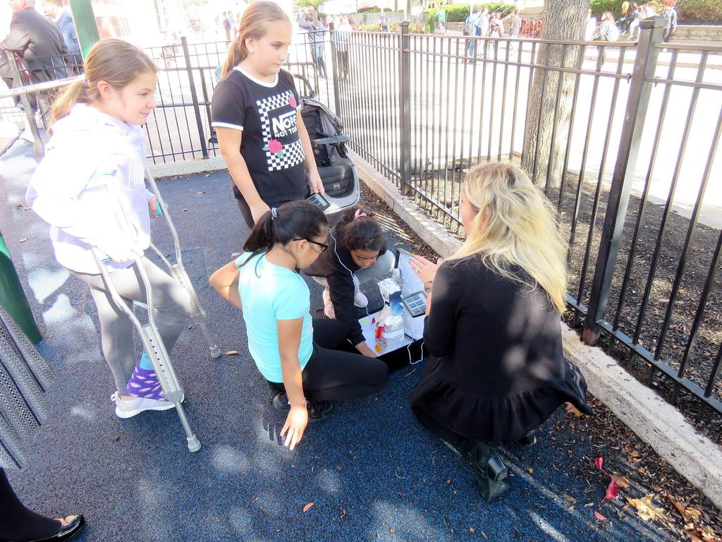 Mrs. Barrett works with students on the Lafayette playground