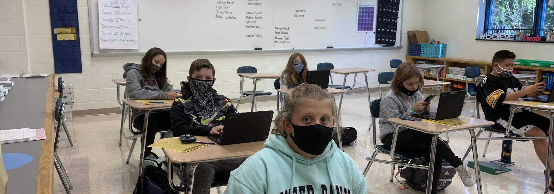 Sixth grade students in math class