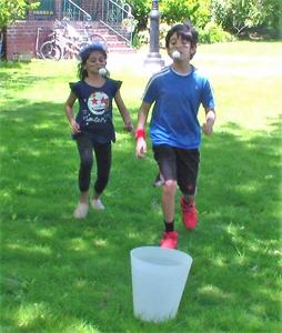 Photo of students enjoying Field Day activities in their backyard.