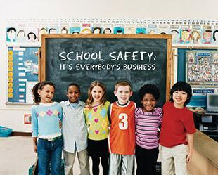 children in front of classroom chalkboard