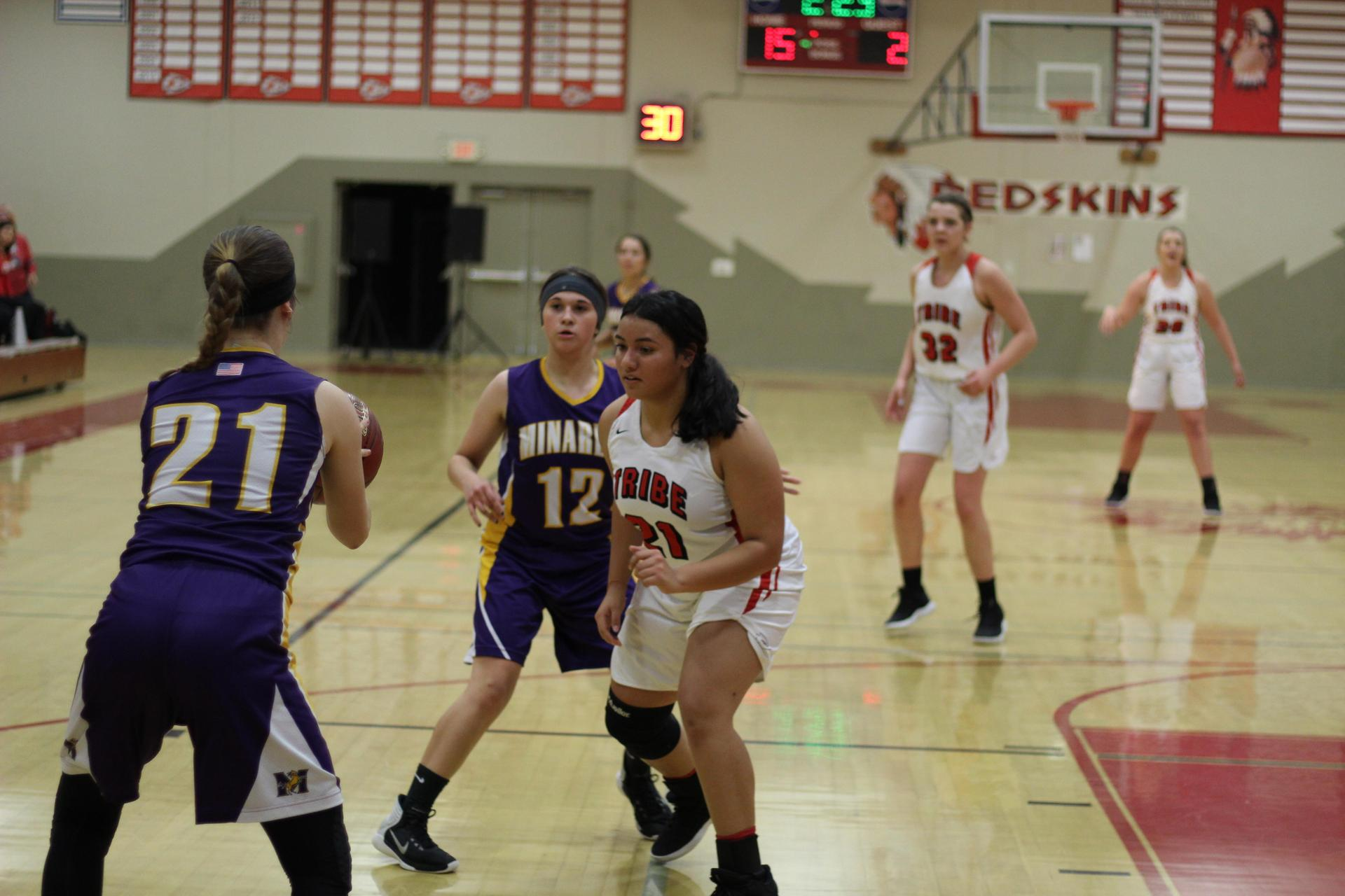 Erykah Negron defending the ball