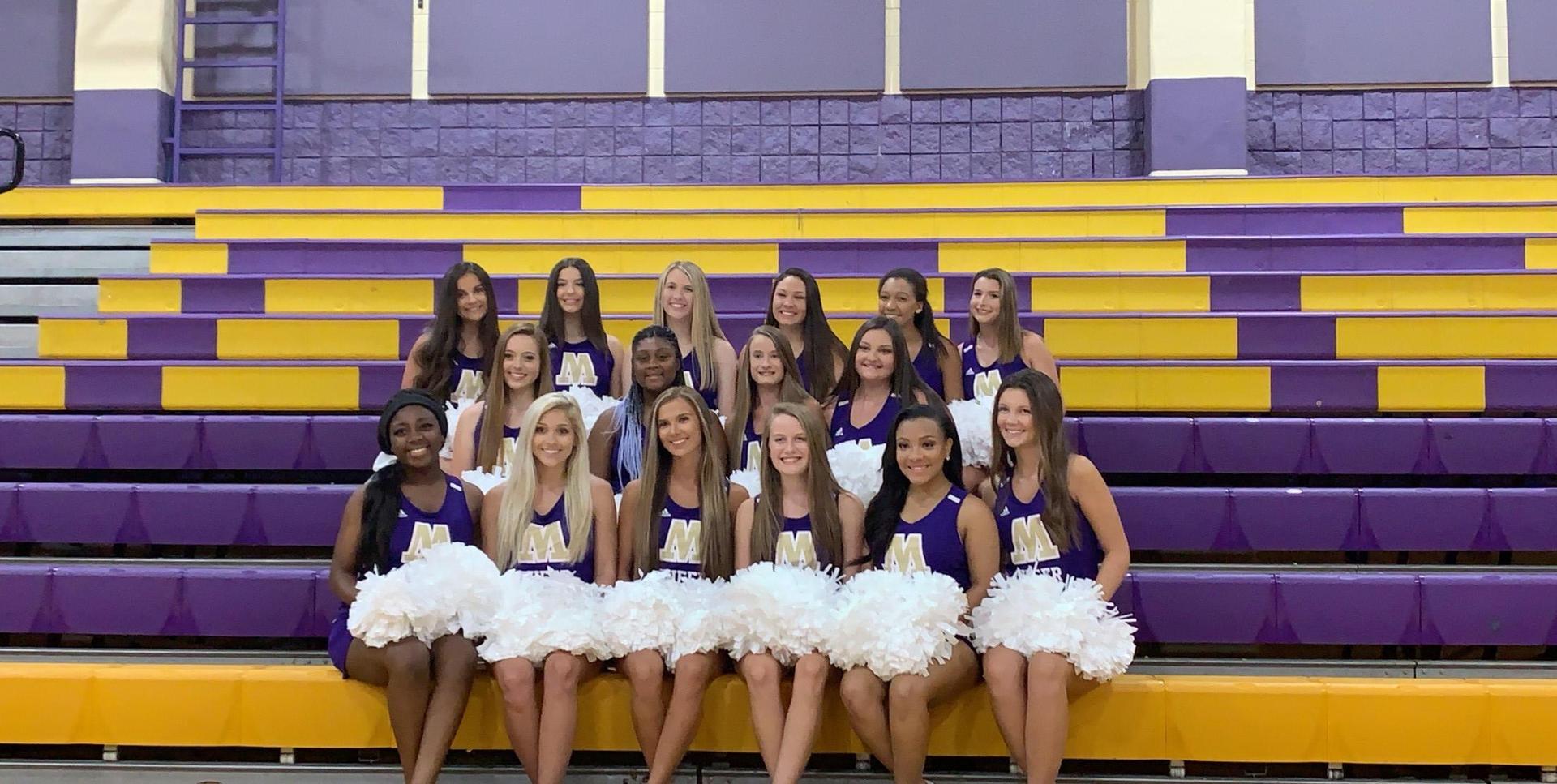 Three rows of Marianna High School Varsity Cheerleaders on purple and gold bleachers.