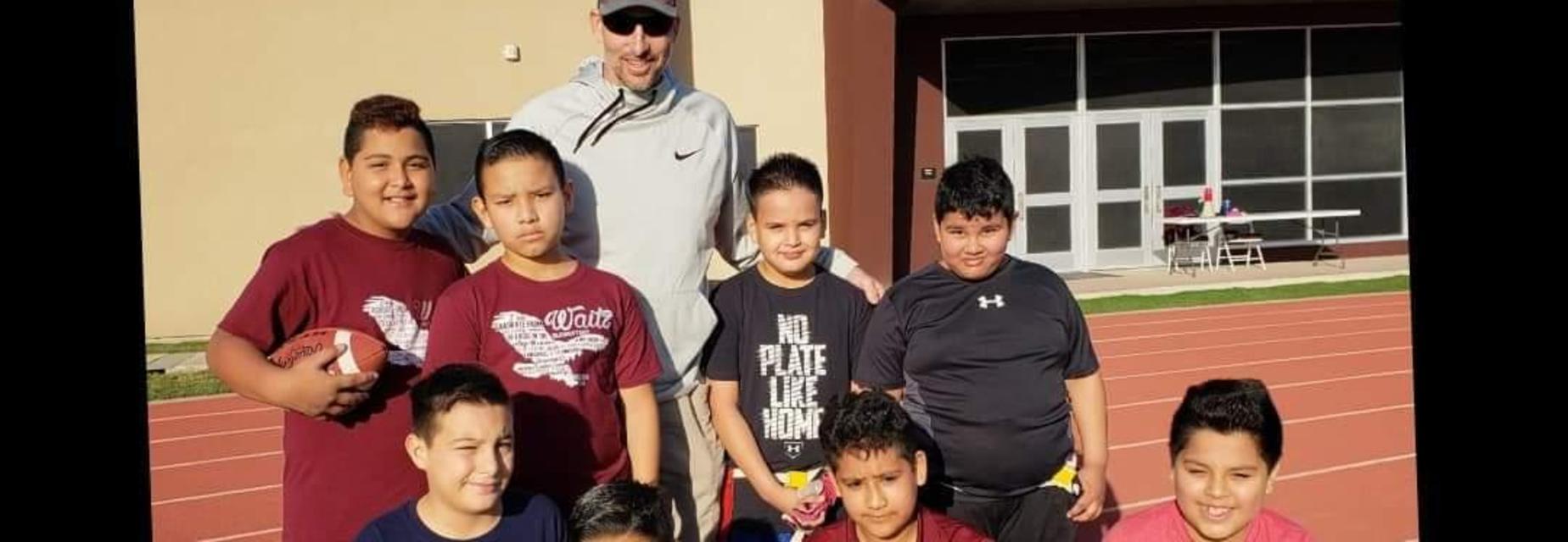 Coach Detmer with boys' football team
