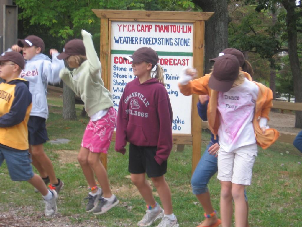 students in line playing at camp