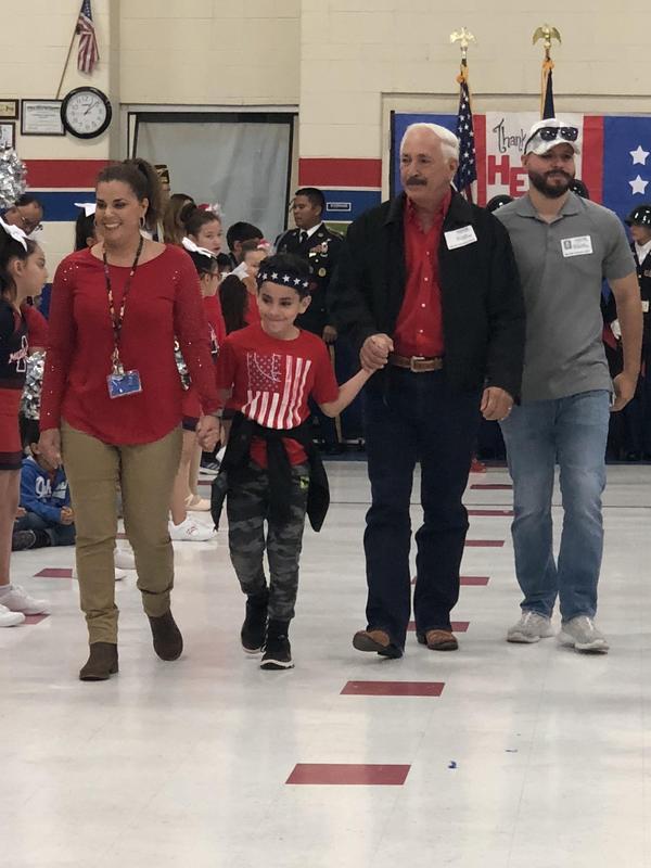 veterans walking into ceremony.