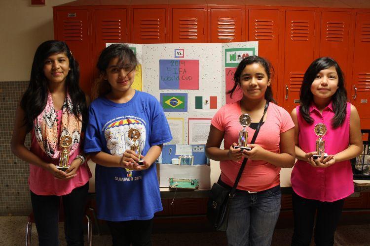 four girls winning trophies