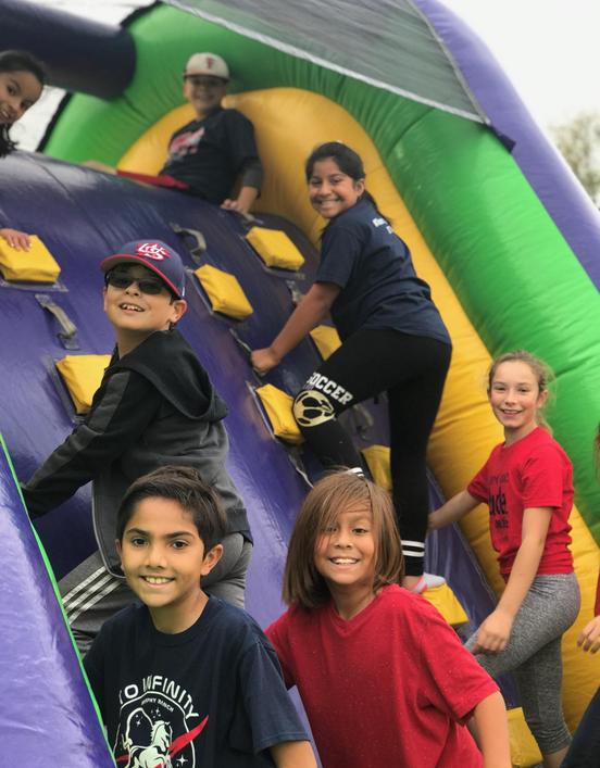 Murphy Ranch students playing in a bounce house.
