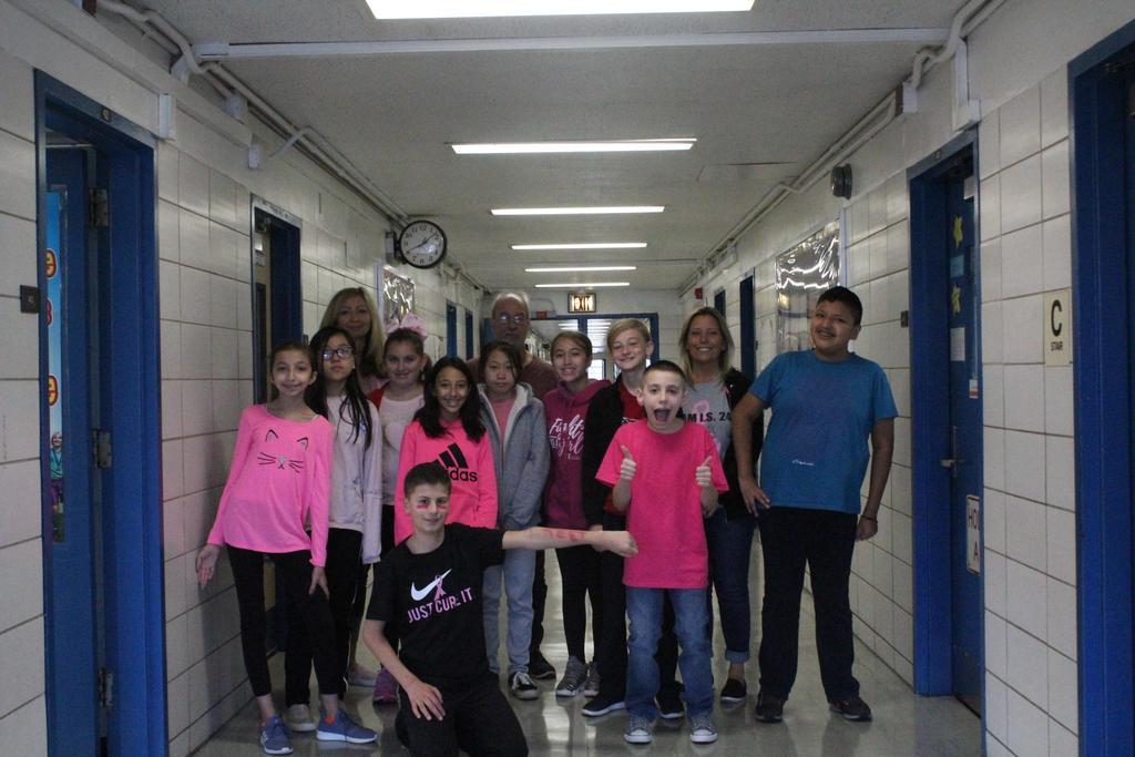 Mrs. Portalatin with seventh grade students