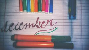 colored pens and the word december