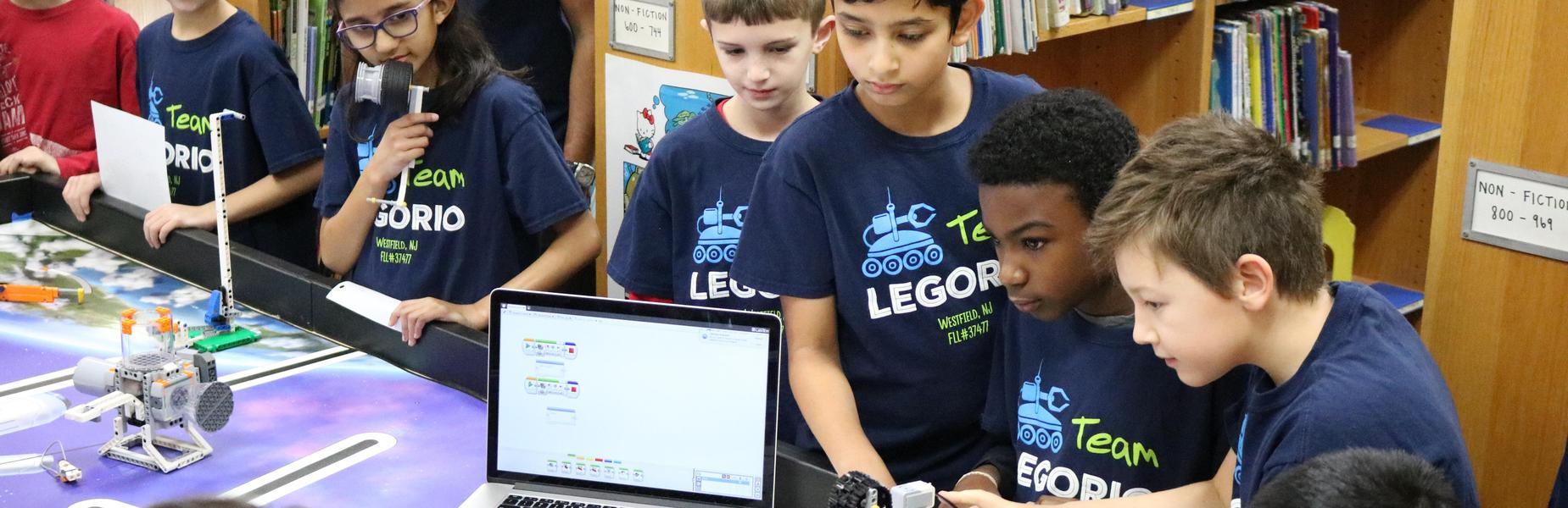 Jefferson School 4th grade Lego Robotics team demonstrate to schoolmates techniques they used during a recent Lego League competition.