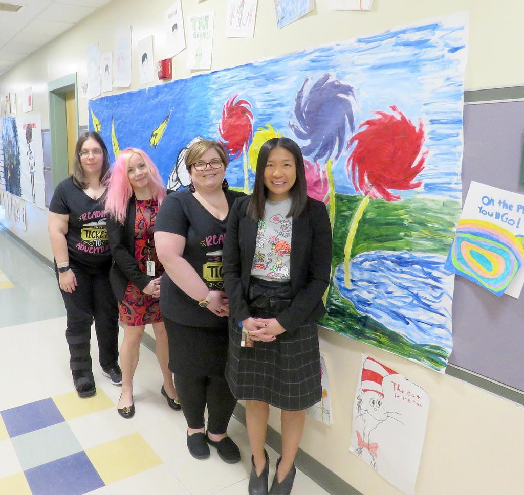 Posed photo, four educators