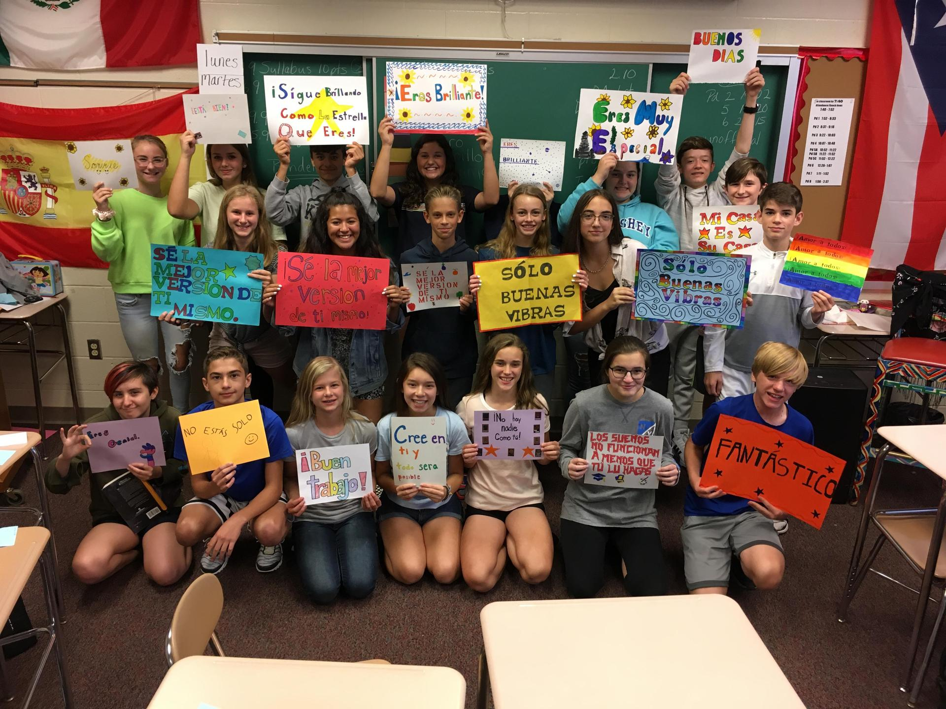 Spanish students with positive posters in Spanish