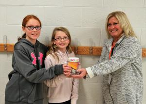 Page students present donations to a local charity.
