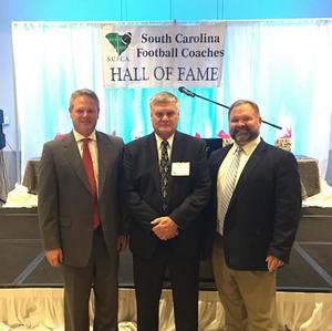 (Left-Superintendent Dr. Darryl Owings, Center-Coach Dave Gutshall, Right-DHS Principal Ken Kiser)