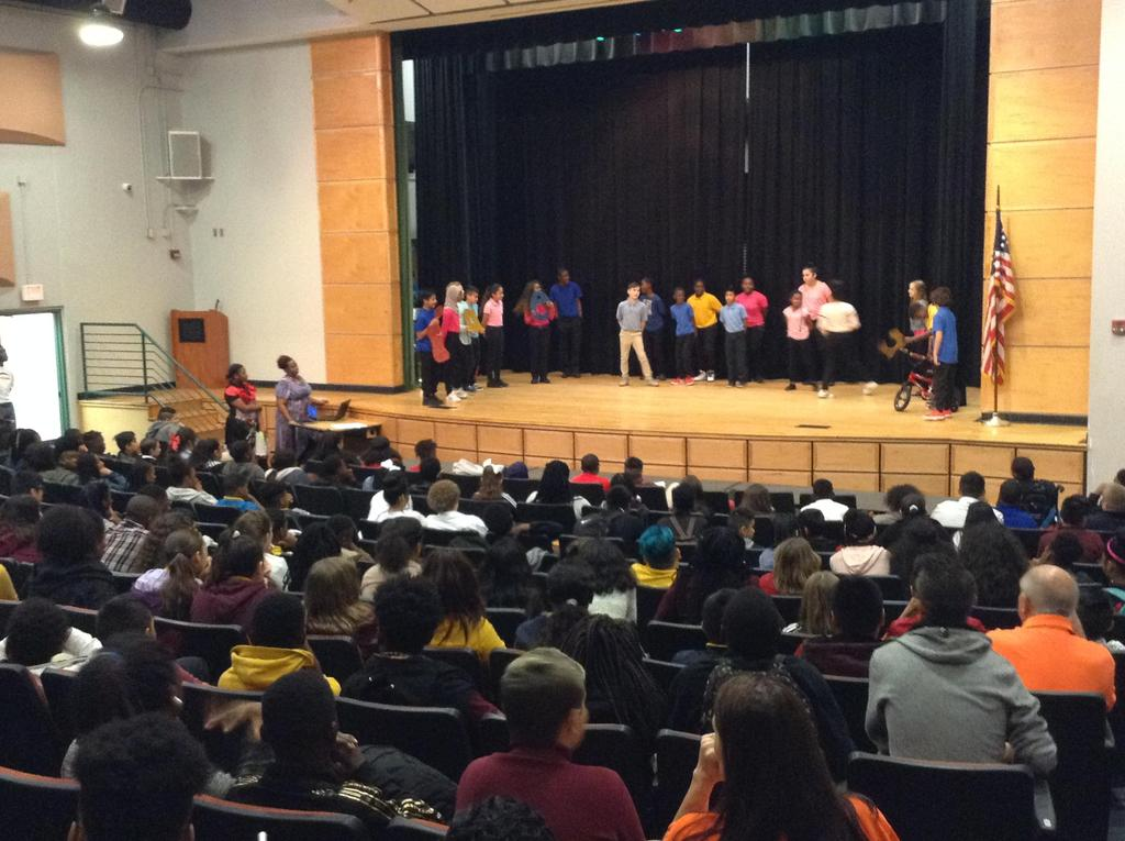 HRMS students perform on stage in Hispanic Heritage Day program
