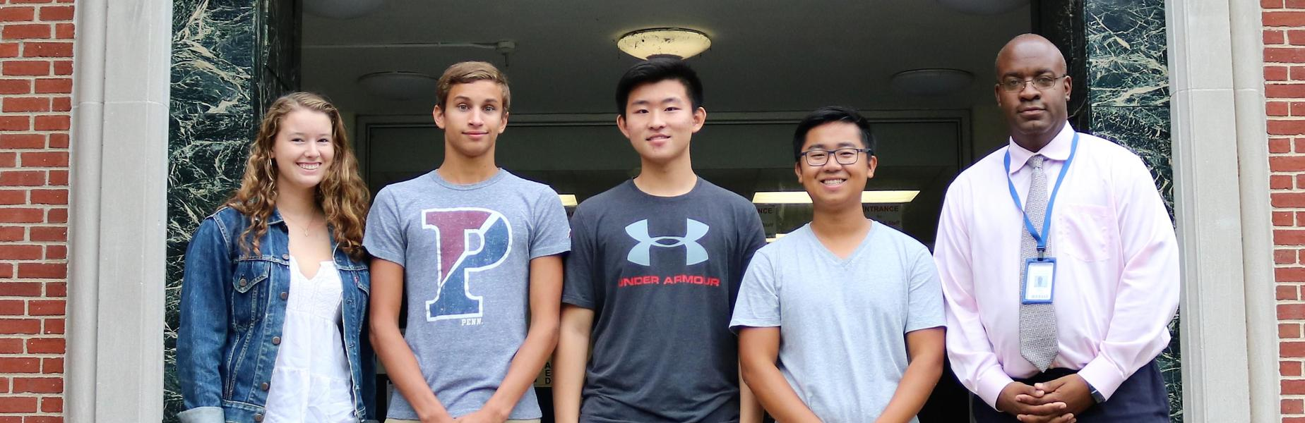 Westfield High School seniors Austin Chen, Madeline Reynders, Edward Xing, and Zachary Youssef have been named semifinalists in the 2019 National Merit Scholarship Competition.  Pictured here with WHS principal Dr. Derrick Nelson.