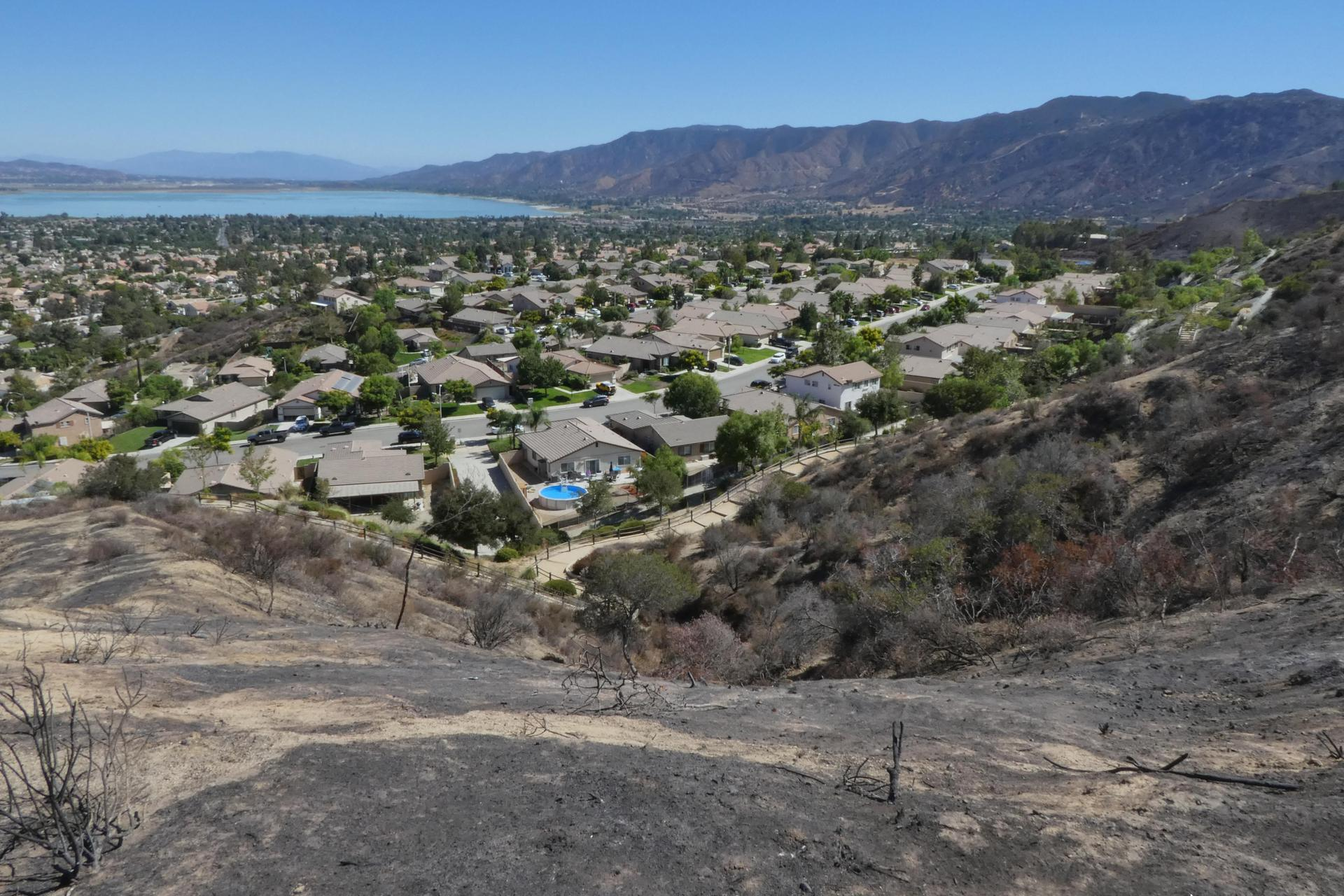 Burn scarred hillsides above homes are vulnerable to debris flow this wet season.