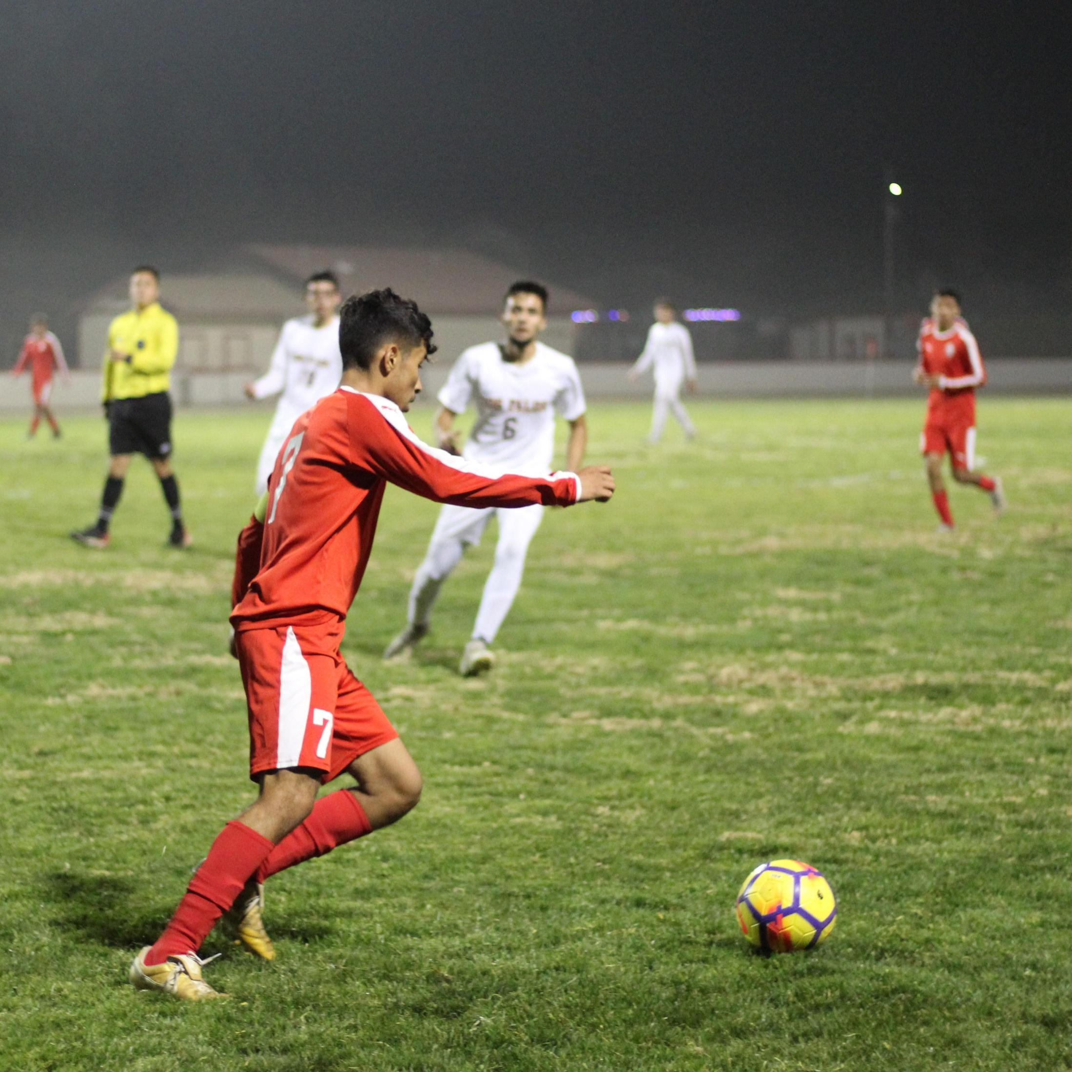Luis Reyes going for the ball