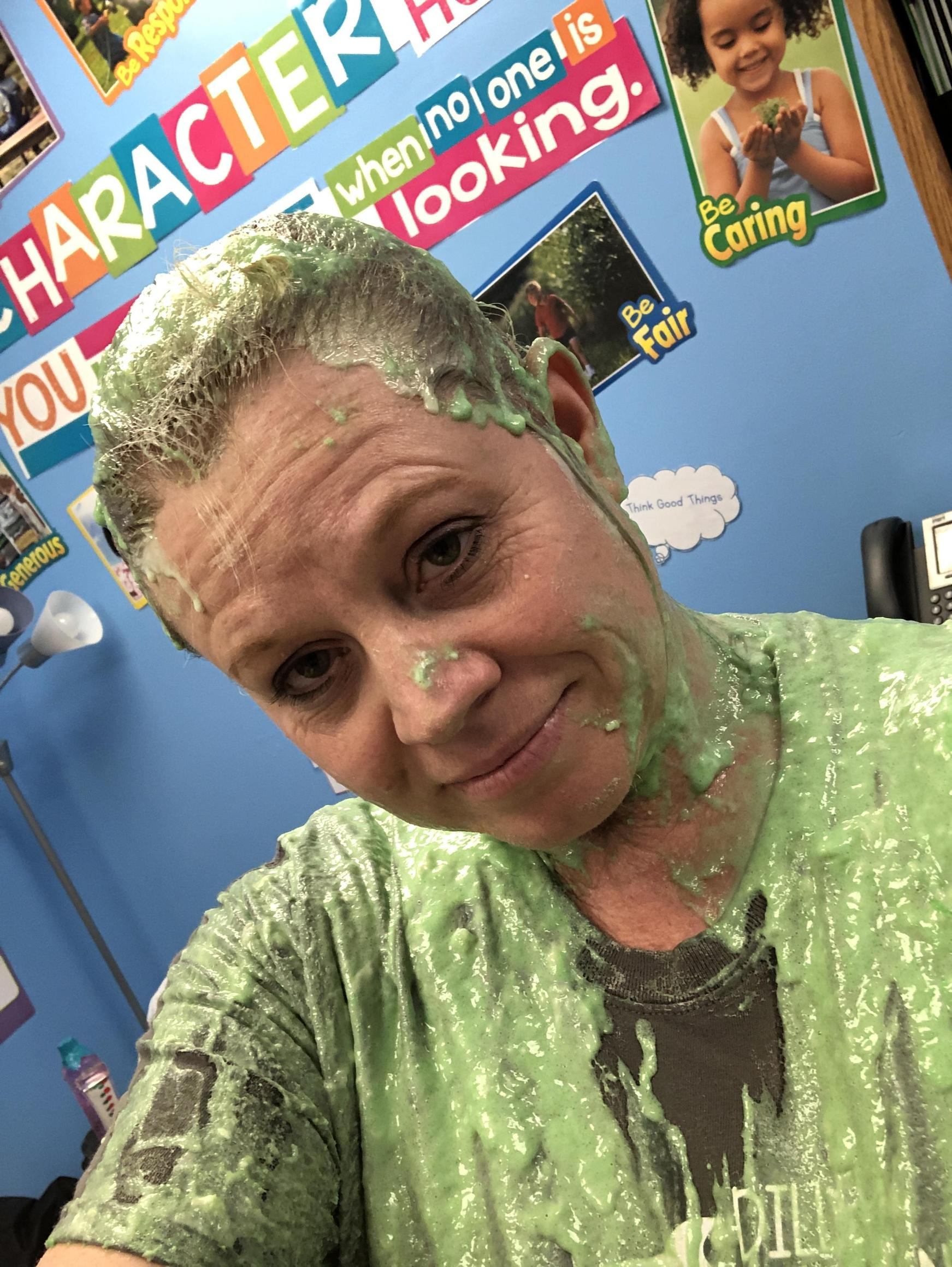 A picture of me after I agreed to be slimed if our students beat an amount raised for a fundraiser.