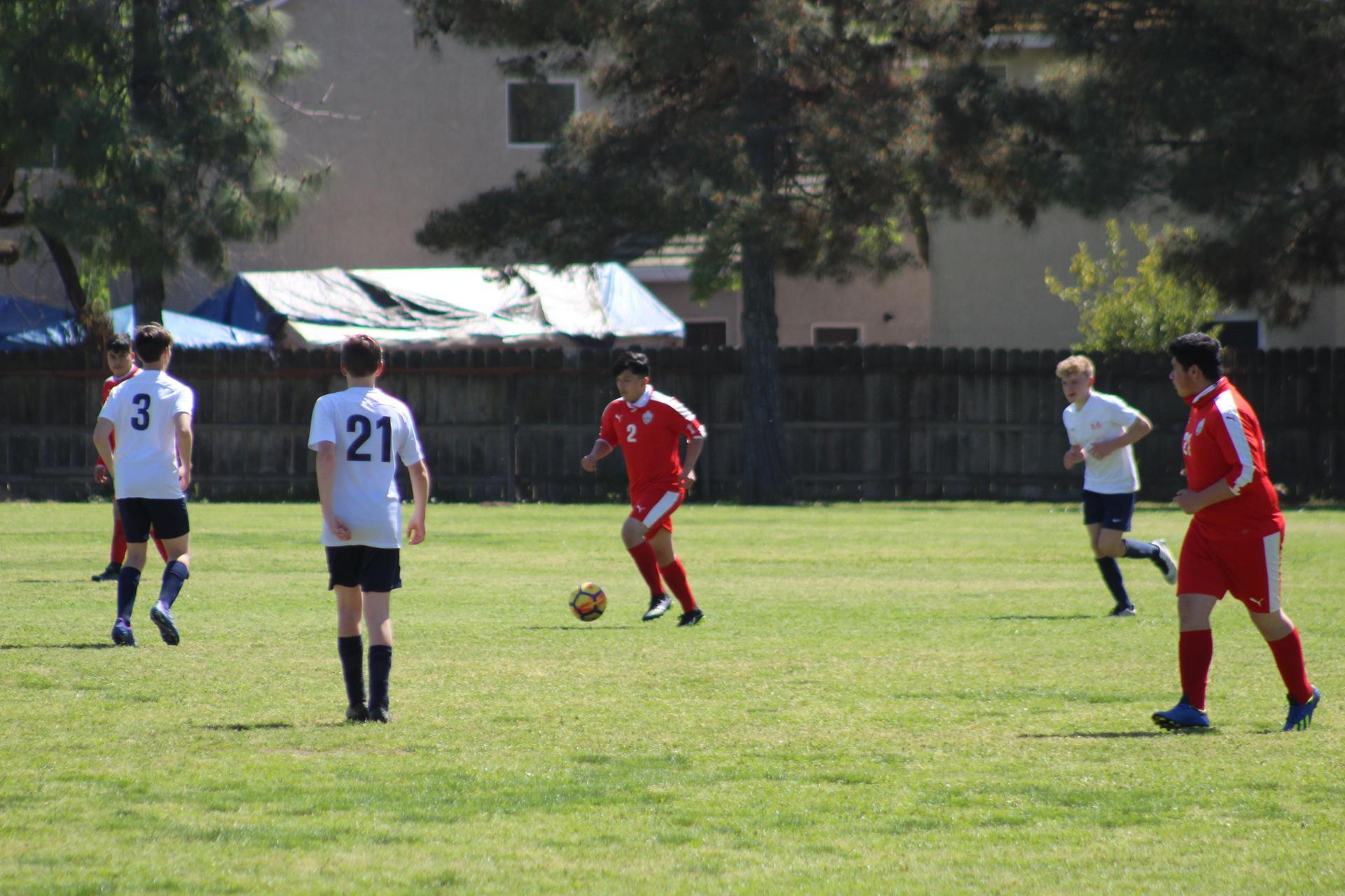 junior Varsity boys playing soccer against san joaquin memorial