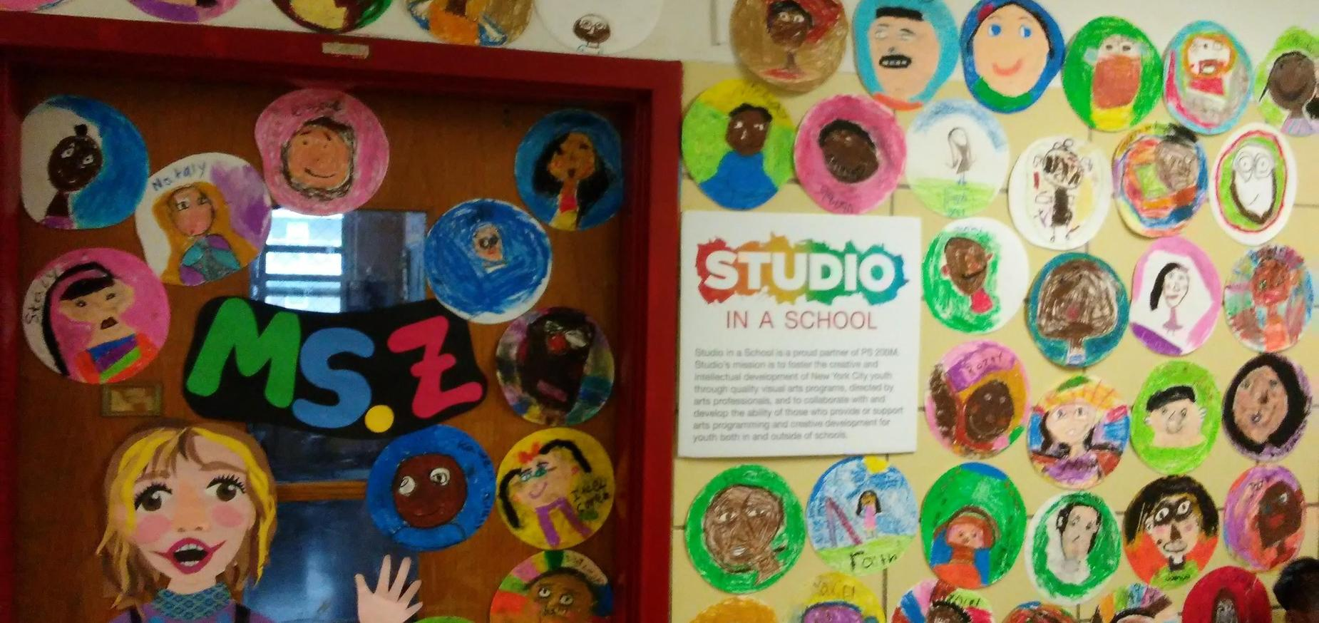 children's art work on the hallway walls