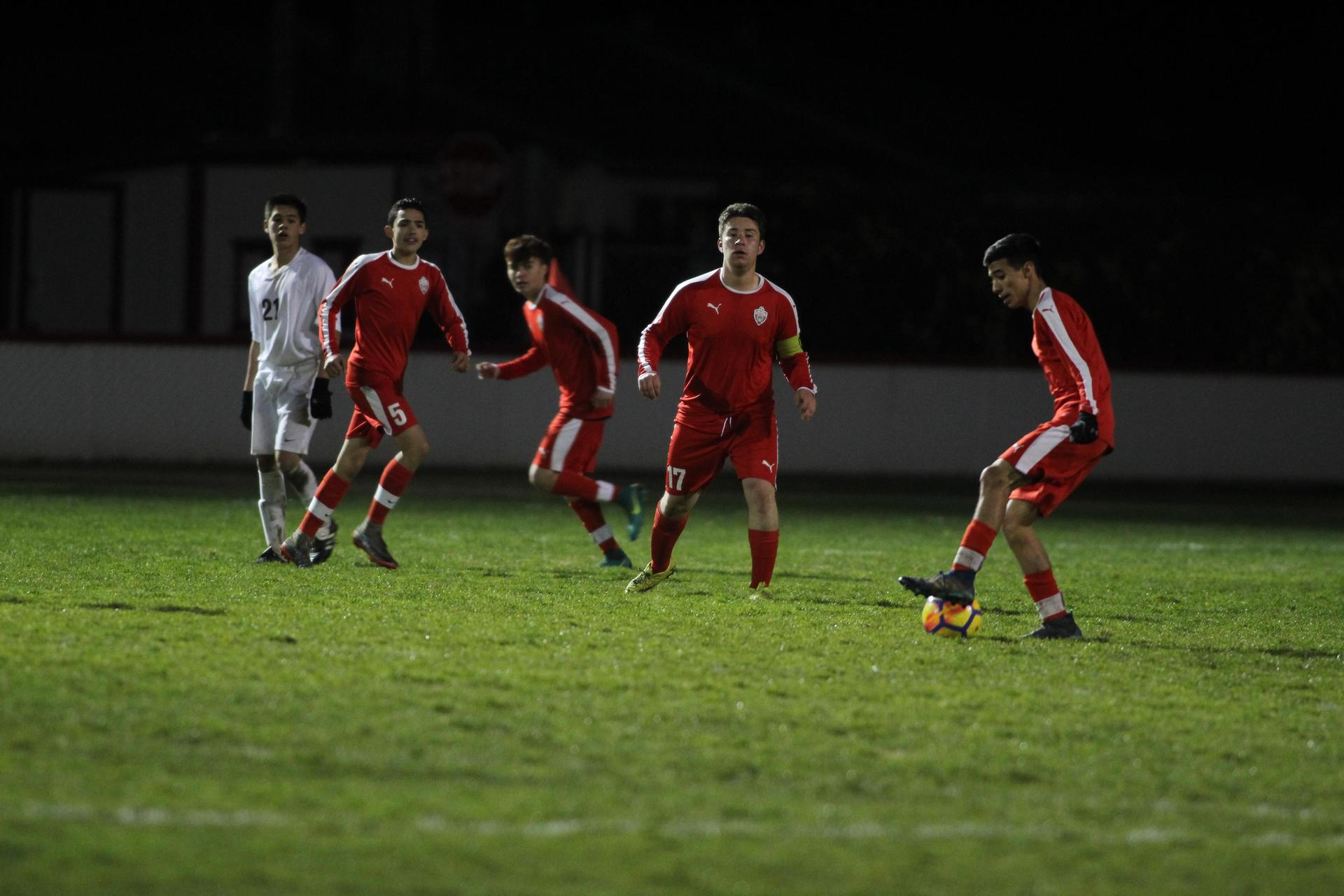 Varsity Boys playing soccer against Sierra