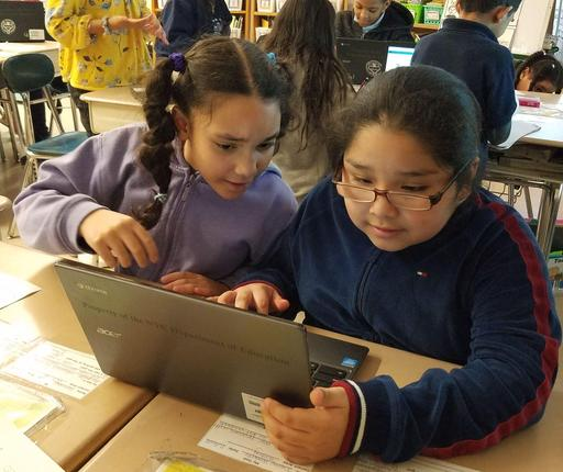 Two students coding on one laptop for CS4ALL 2019 Day.