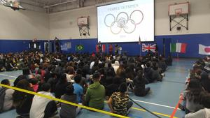 Students and teachers participate in Temple Olympics opening ceremony.
