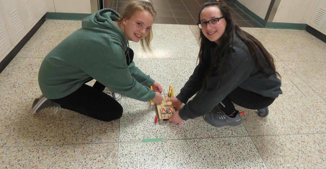 Science Olympiad students work on their mouse trap race car.