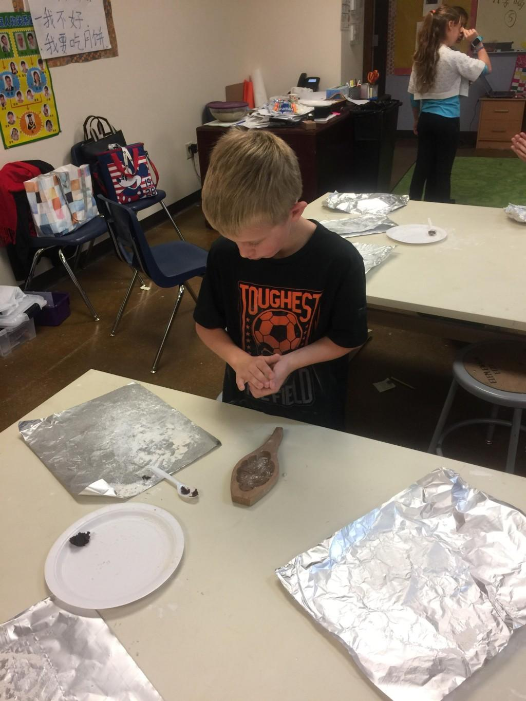 Elementary Schoolers have fun at the moon cake party in Chinese class.