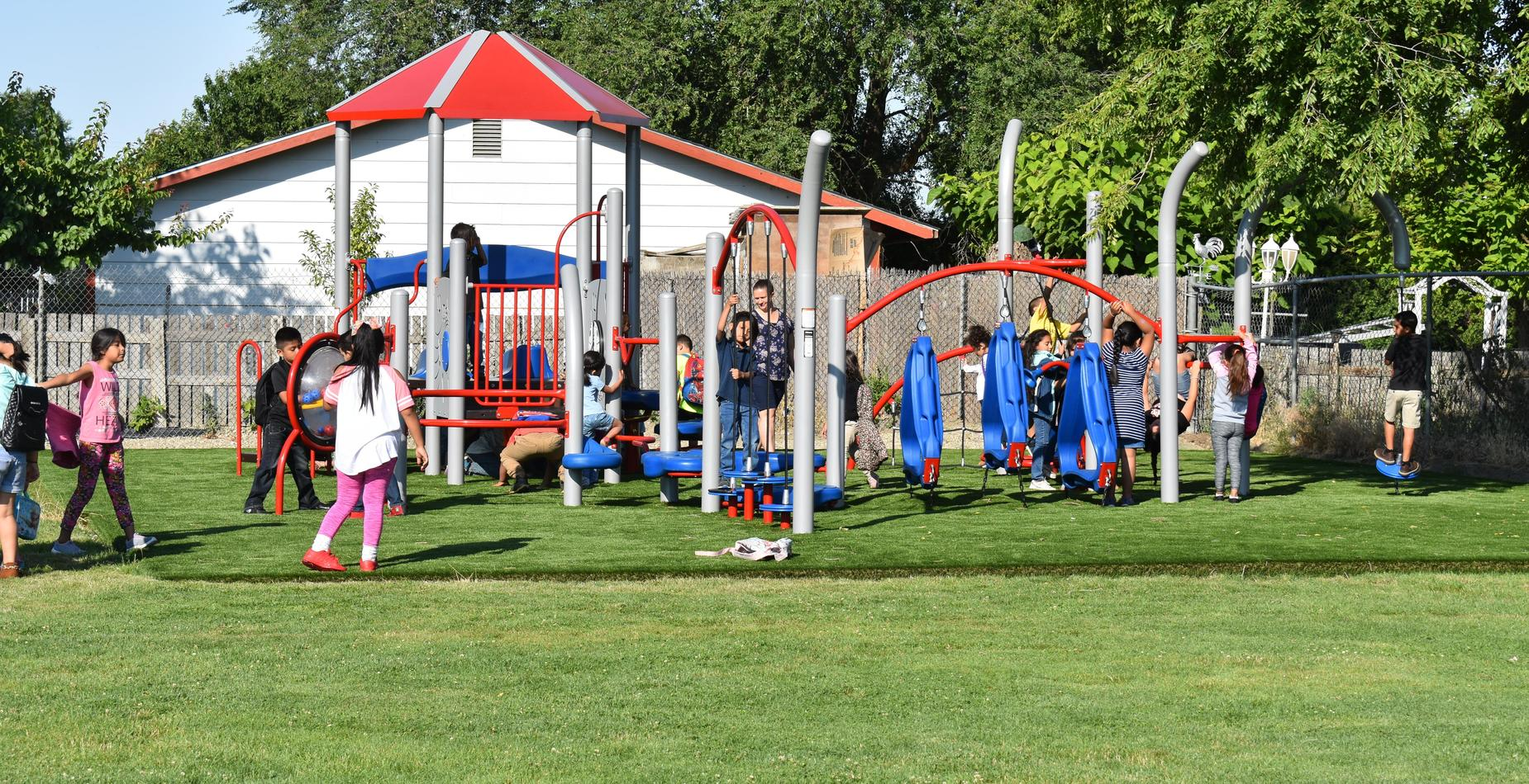 Summer school students playing on the new playground equipment.