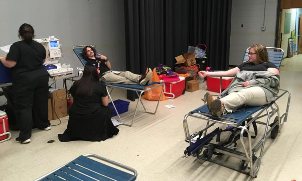 Students donate blood at blood drive