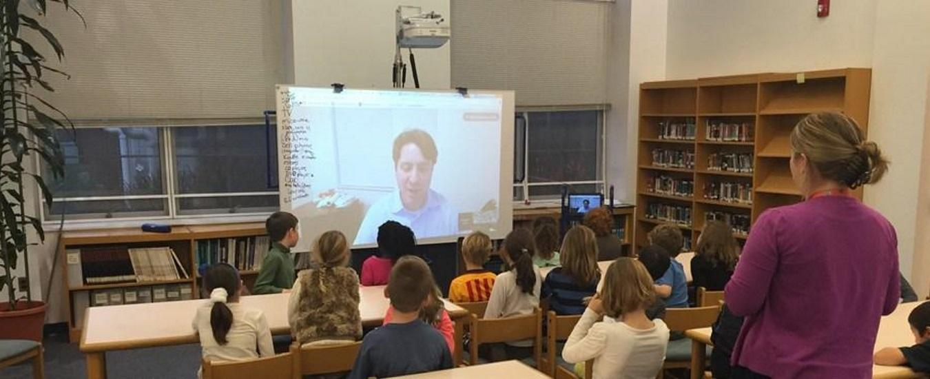 A class participates in a video conference