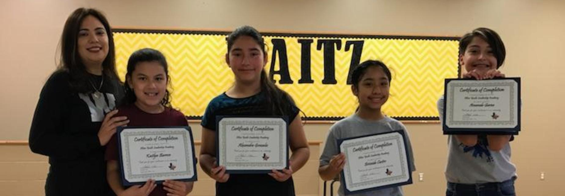 Alton Youth Leadership Academy participants receiving certificate