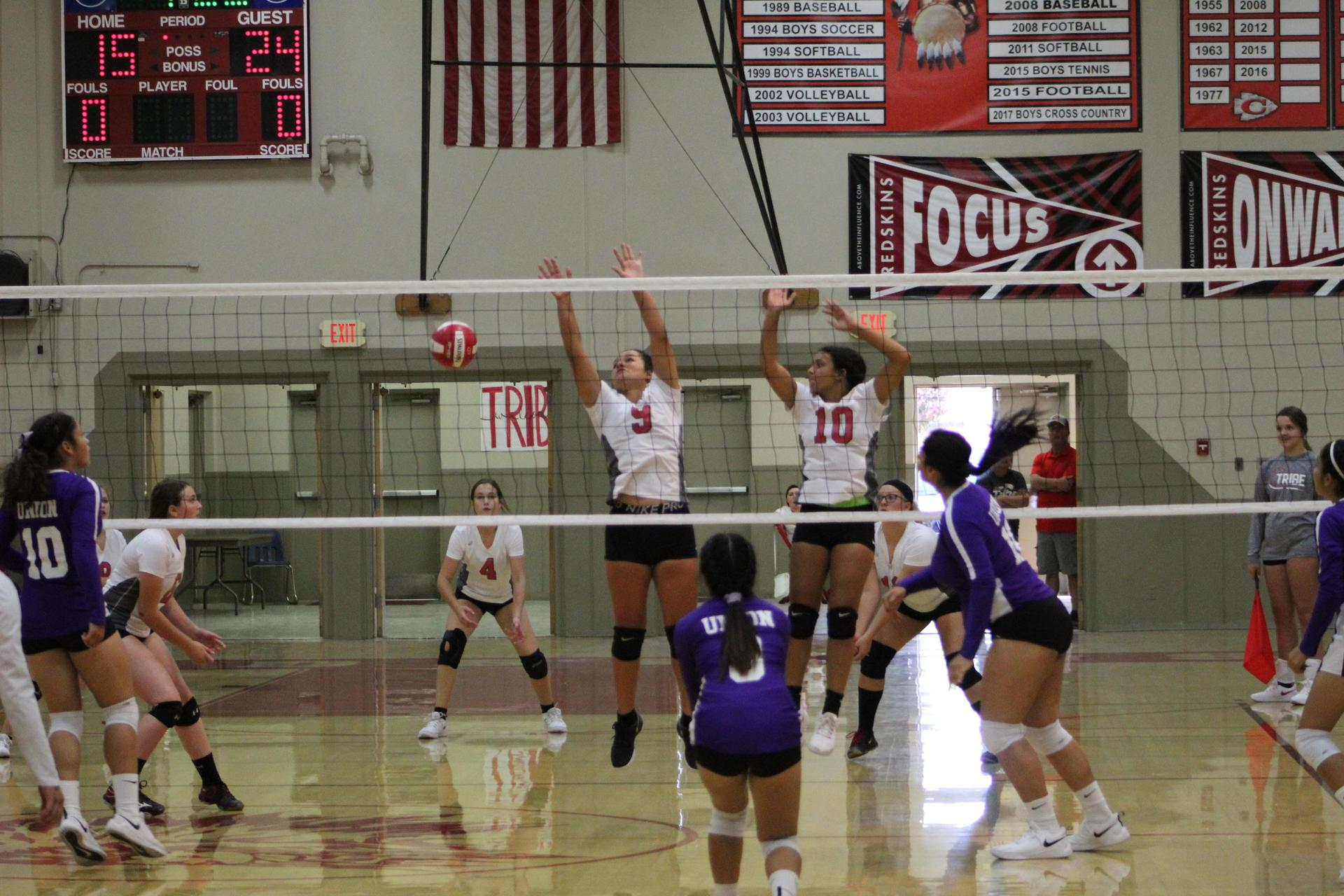 Junior Varsity Girls playing volleyball against Washington