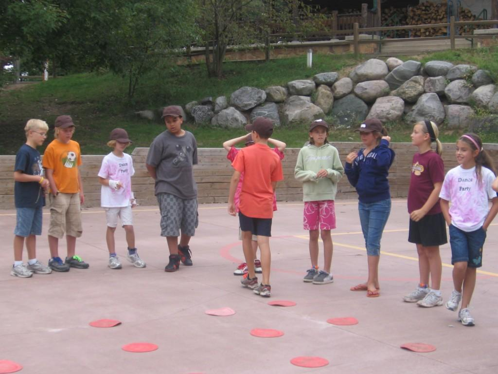 kids line up to play game at camp