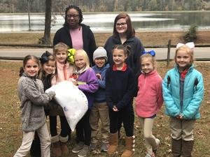 Southeast Elementary students donating socks to Care Lodge Domestic Violence Shelter.