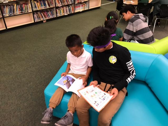 CCA students read to elementary school students.