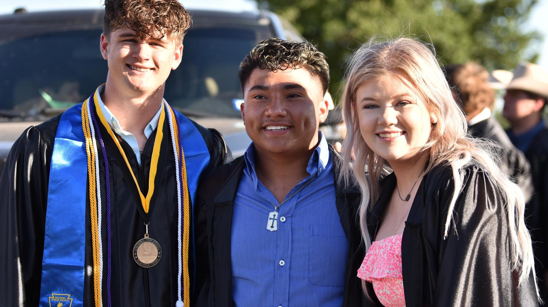 three graduating seniors